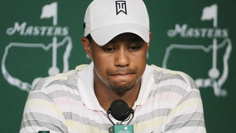 Tiger Woods speaks during his press conference at