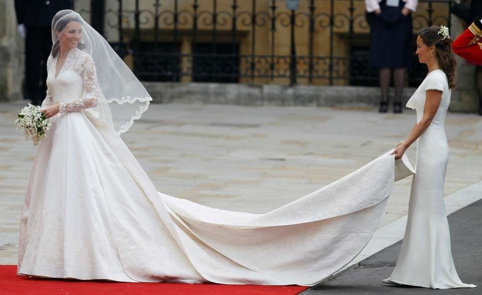 Kate Middleton, left, is accompanied by her maid