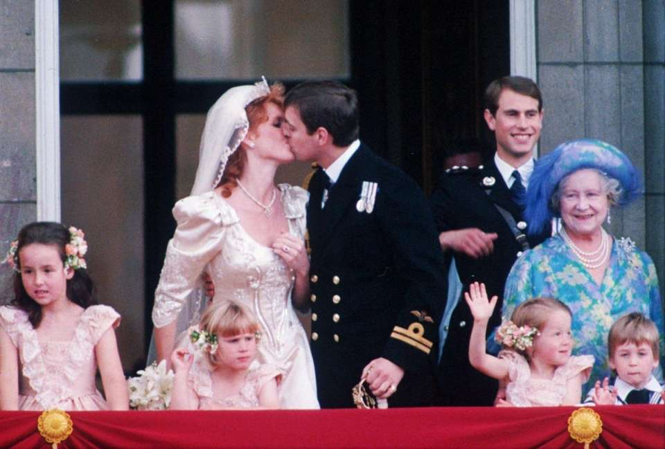 Prince Andrew kisses his bride Sarah Ferguson on