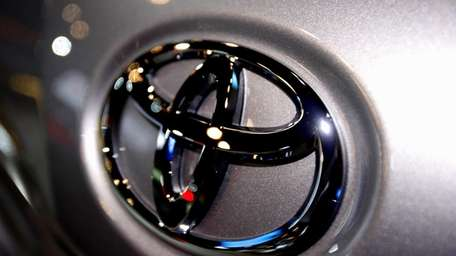 The Toyota logo is seen on a car