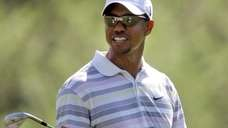 Tiger Woods plays a practice round at the
