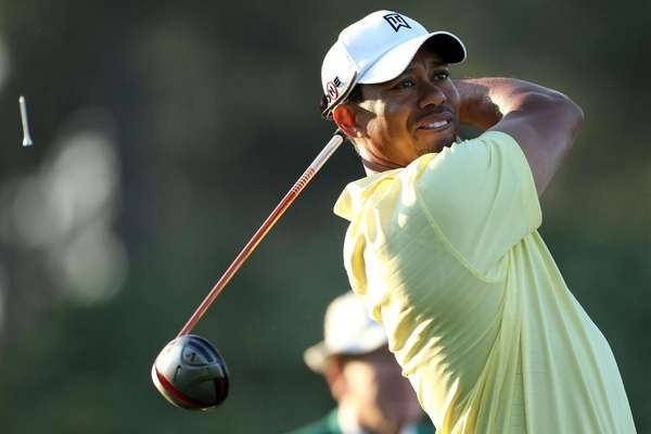 Tiger Woods plays a shot during a practice