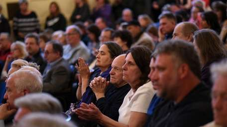 Residents attend a packed meeting in Bayville on