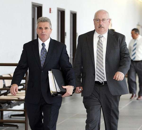 Detective John McLeer, left, of the Suffolk County