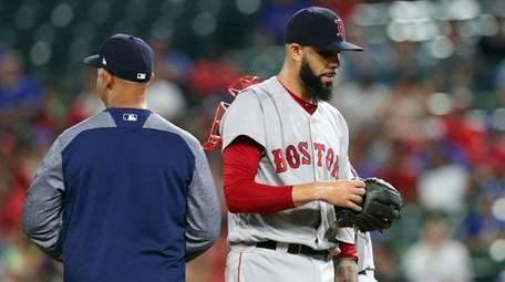 Red Sox starting pitcher David Price walks off