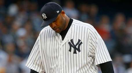Yankees pitcher CC Sabathia stands on the mound