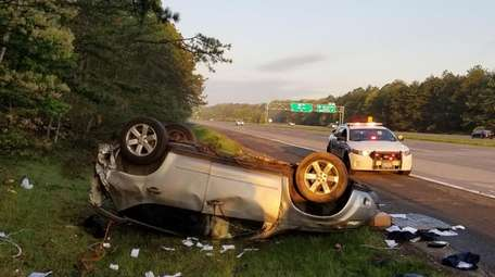 An SUV overturned after crashing Friday on the