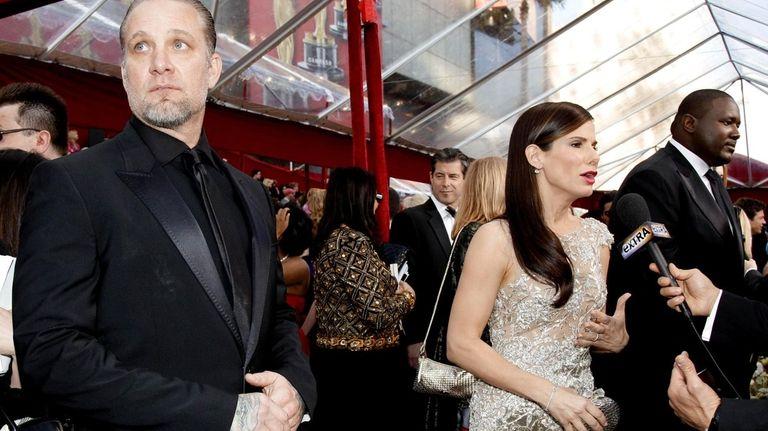 Sandra Bullock is interviewed next to her husband,
