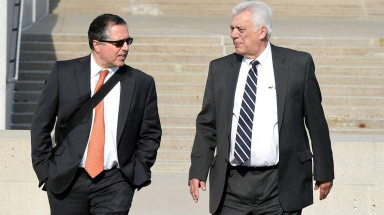 Attorney Marc Agnifilo, left, walks out of federal