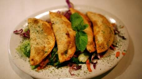 Sambooseh, crispy pastry turnovers stuffed with vegetables and