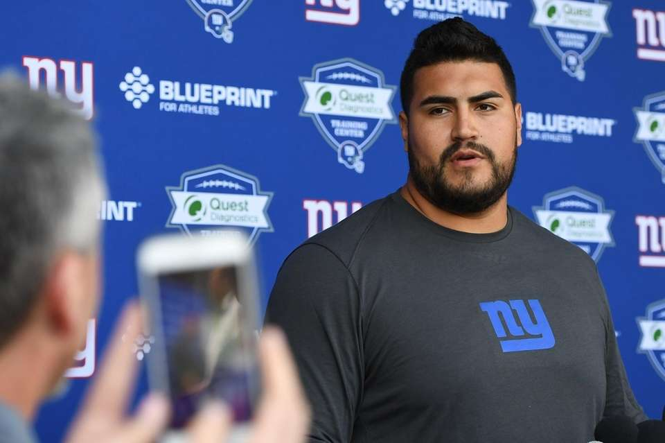 Giants guard Will Hernandez speaks to the media