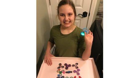 Kidsday reporter Sydney Schoettl with her fidget spinner