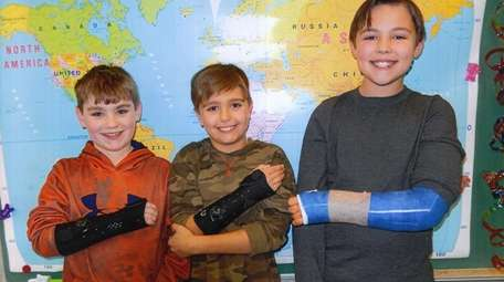 Kidsday reporters with their broken arms, from left,