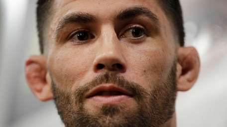 Dominick Cruz speaks during a media day for