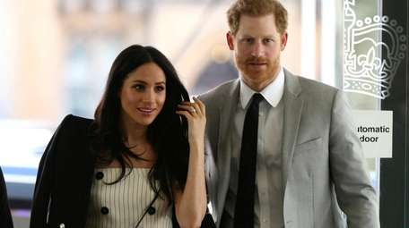 Prince Harry and Meghan Markle attend a reception