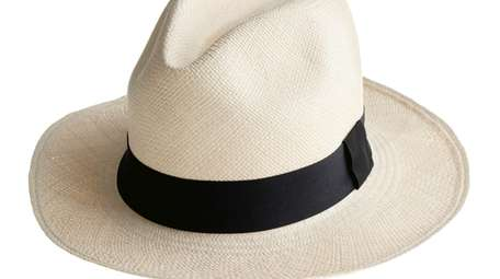 Markle wore this Panama-style straw hat while