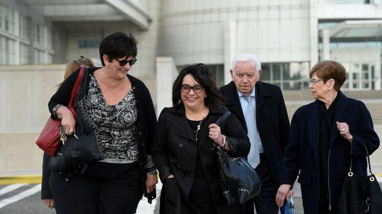Linda Mangano, center, leaves federal court in Central