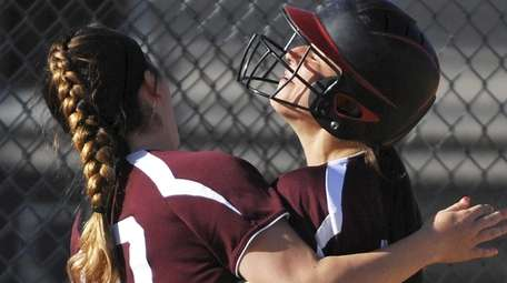 Mepham shortstop Kelsey Vandewater right, gets congratulated by