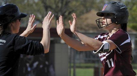 Mepham's Jenna Giliberti gets congratulated after reaching first