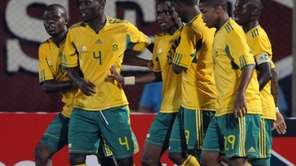 South Africa celebrates after scoring against Paraguay during