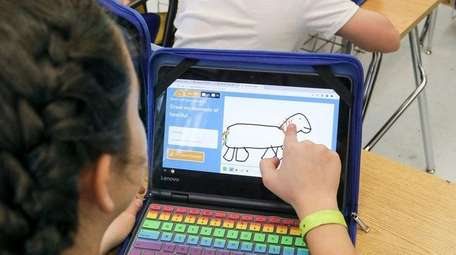 Sixth-graders use school-issued Chromebook computers to work on