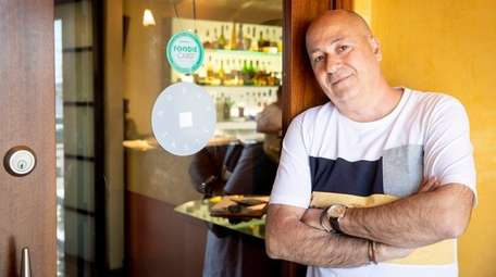 Neil Foster, founder of Foodie Card, poses at