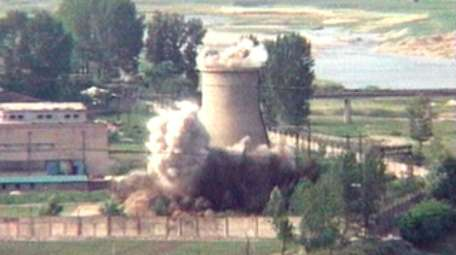 Demolition of the 60-foot-tall cooling tower at its