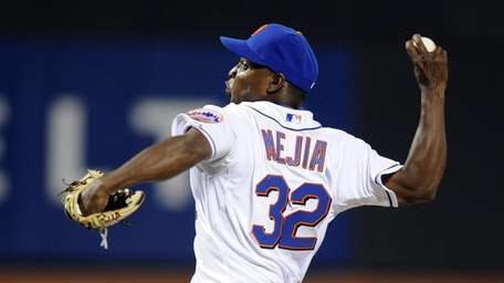 Jenrry Mejia pitching in the 6th inning in