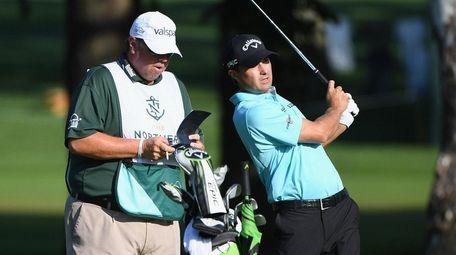 Caddie Duane Bock stands with golfer Kevin Kisner