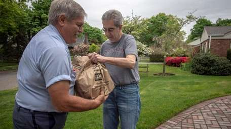Mail carrier Rich Lepis picks up food donated
