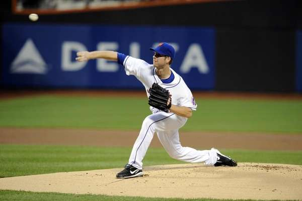 John Maine pitching early in the game at