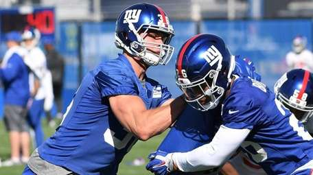 Giants tight end Connor Davis, left, participates in