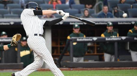 Yankees first baseman Neil Walker hits the game-winning