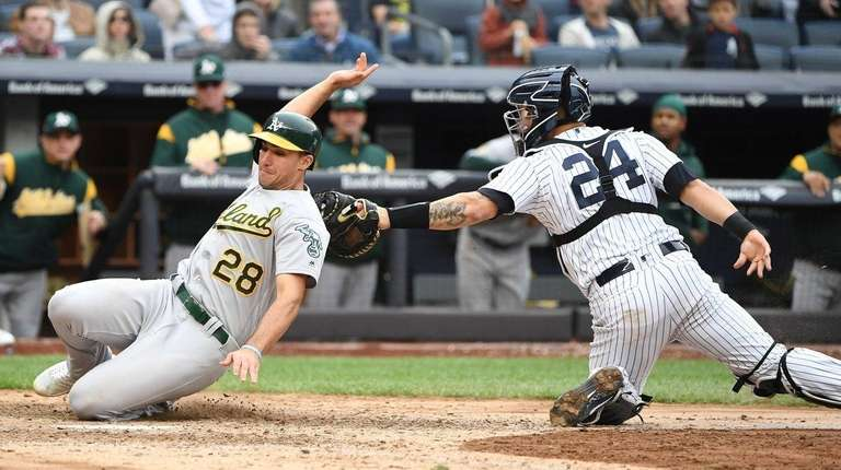 Yankees catcher Gary Sanchez tags out Athletics first