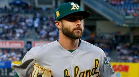 Athletics outfielder Dustin Fowler runs to the dugout