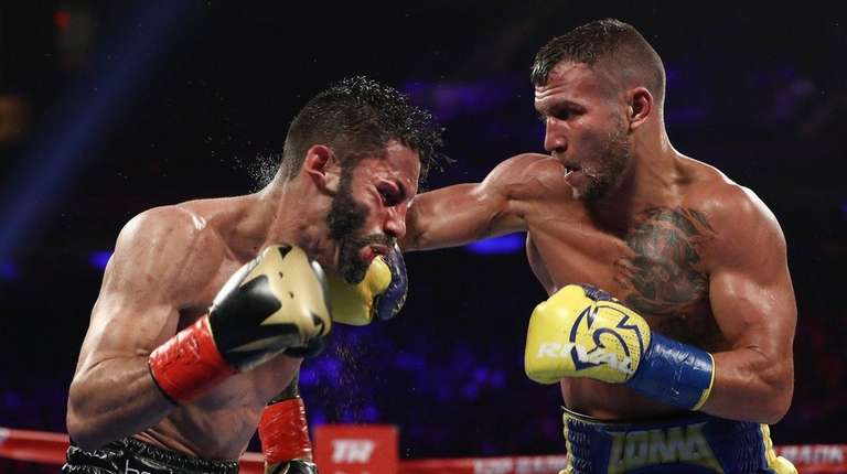 Vasiliy Lomachenko punches Jorge Linares during their WBA