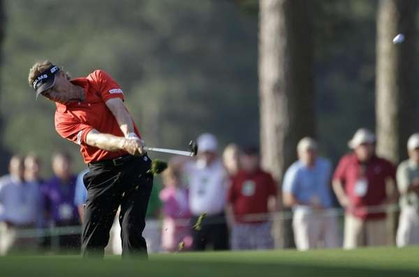 Bernhard Langer hits off the first fairway during