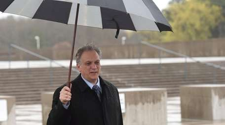 Edward Mangano outside the federal courthouse in Central