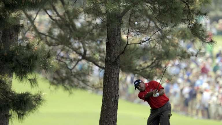 Angel Cabrera hits from the rough on the