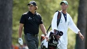 Phil Mickelson and caddie Jim MacKay walk down