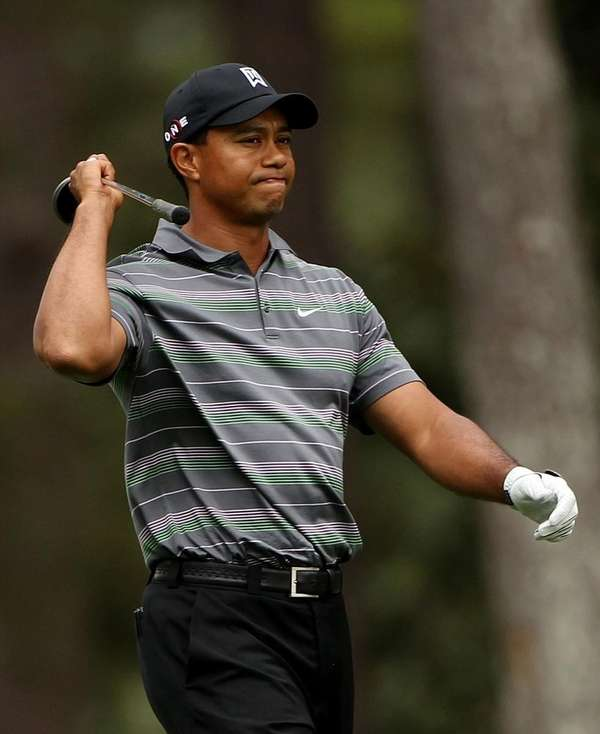 Tiger Woods reacts to a poor shot on