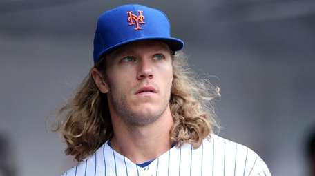 Mets starting pitcher Noah Syndergaard in the dugout