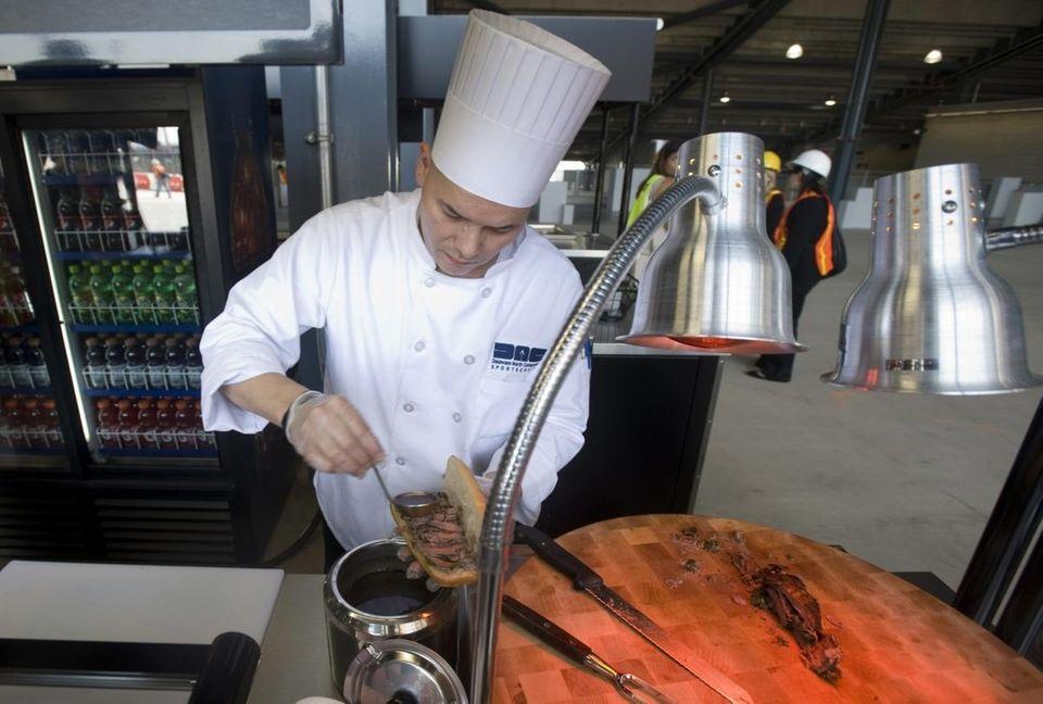 Sous-chef Camilo Baquero pours a port wine demi-glaze