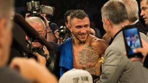Vasiliy Lomachenko smiles after his victory against Jorge