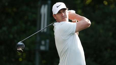 Brooks Koepka hits from the 11th tee during