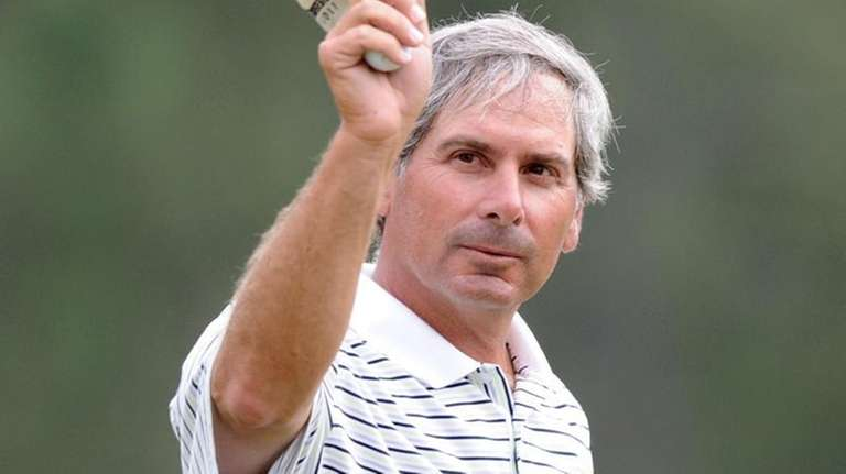 Fred Couples walks off the 18th green after