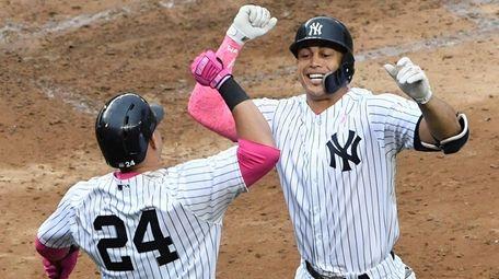 Yankees designated hitter Giancarlo Stanton celebrates with catcher