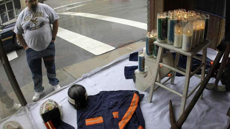 A man looks at a window display made
