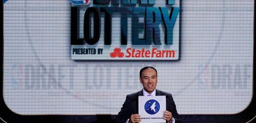 NBA deputy commissioner Mark Tatum announces the draft