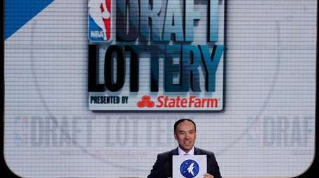 NBA deputy commissioner Mark Tatum announces the draft
